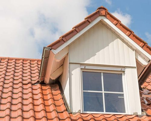 White Dormer window with metal cladding in wood look