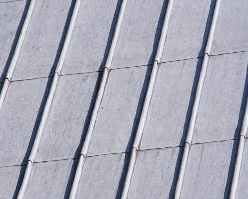 Close-up of lead sheeting on church roof with strong diagonal lines