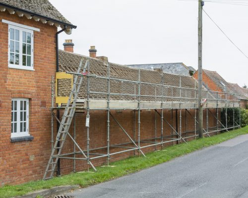 Scaffolding and roof repairs, replacing roof tiles on a rural house in Buckinghamshire, UK